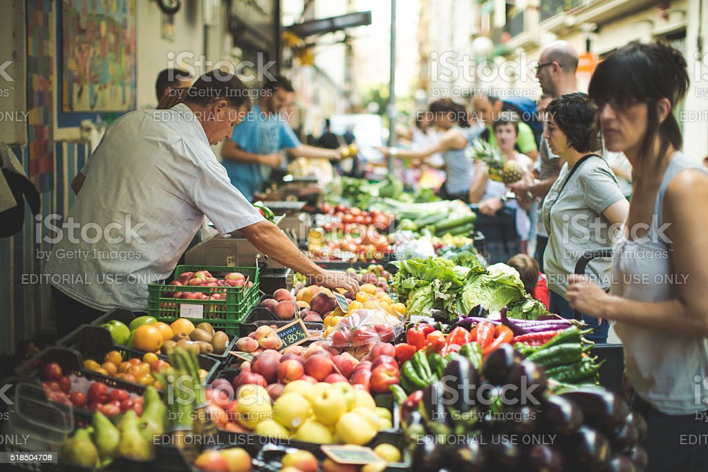 Fruits and grocery at Boqueria market in Barcelona stock photo