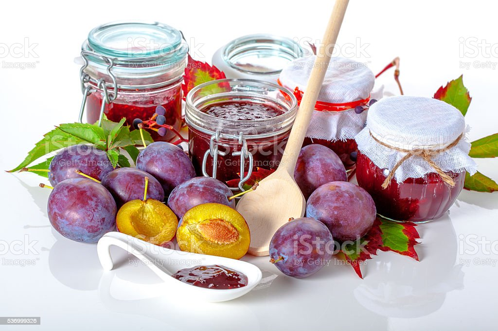 Fruits and jam jars stock photo