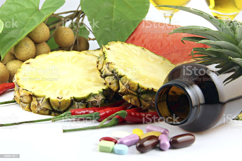 Fruits and medicines placed near the cosmetics. royalty-free stock photo