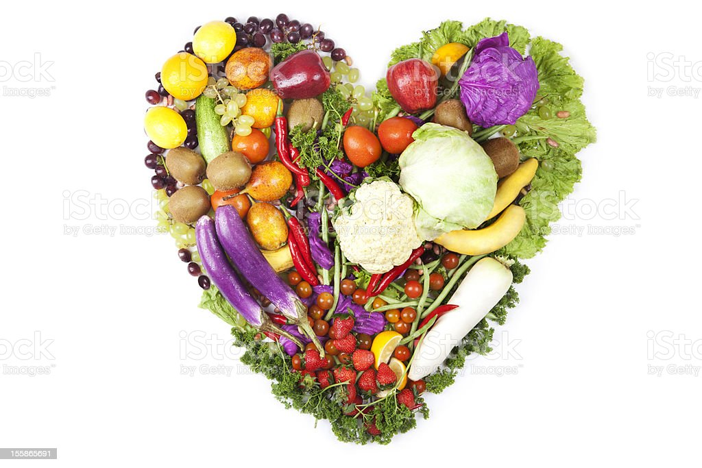 Fruits and vegetables arranged in a heart shape stock photo