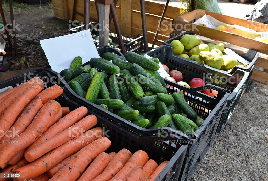 Fruits and vegetables at a farmers market for sale. stock photo