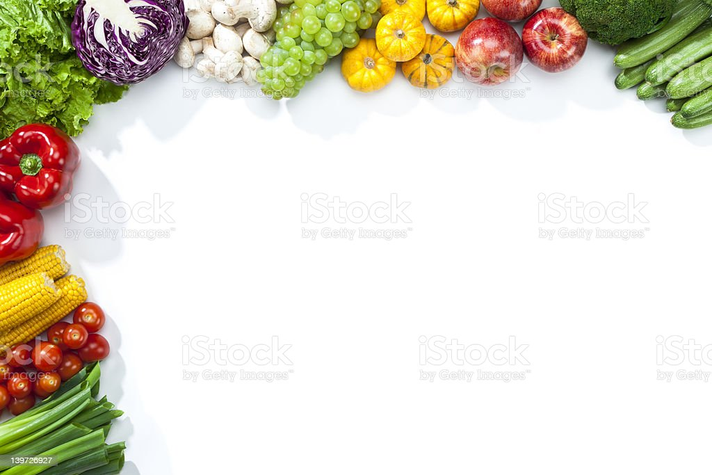 Fruits and vegetables disposed on a half frame shape stock photo