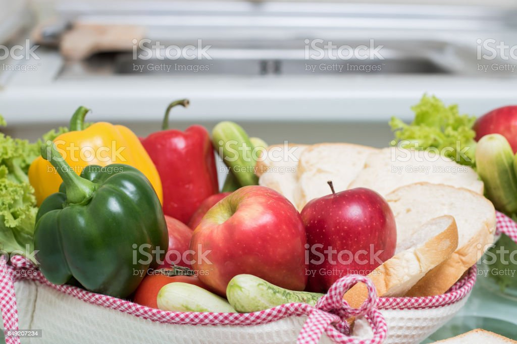 Fruits and vegetables for good health are placed on the table in the kitchen. stock photo