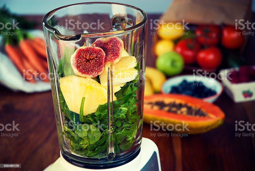 Fruits and vegetables in the blender stock photo