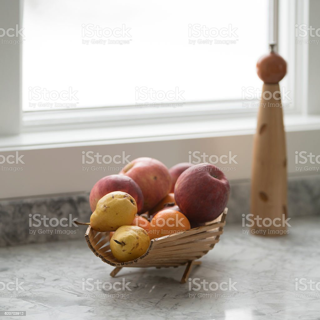Fruits, apples, peaches and oranges, in the wooden vase stock photo
