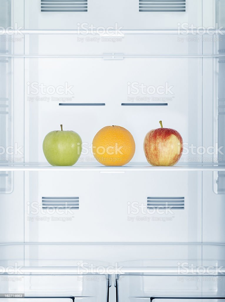 Fruits in the refrigerator stock photo