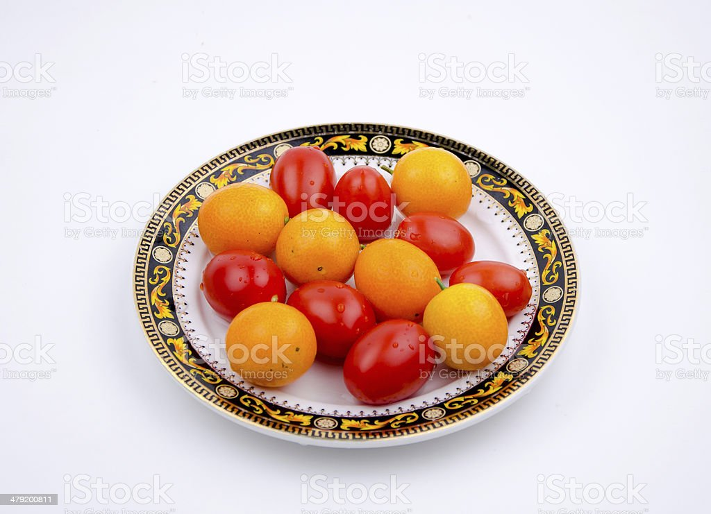 Fruits: little orange and cherry tomatoes royalty-free stock photo