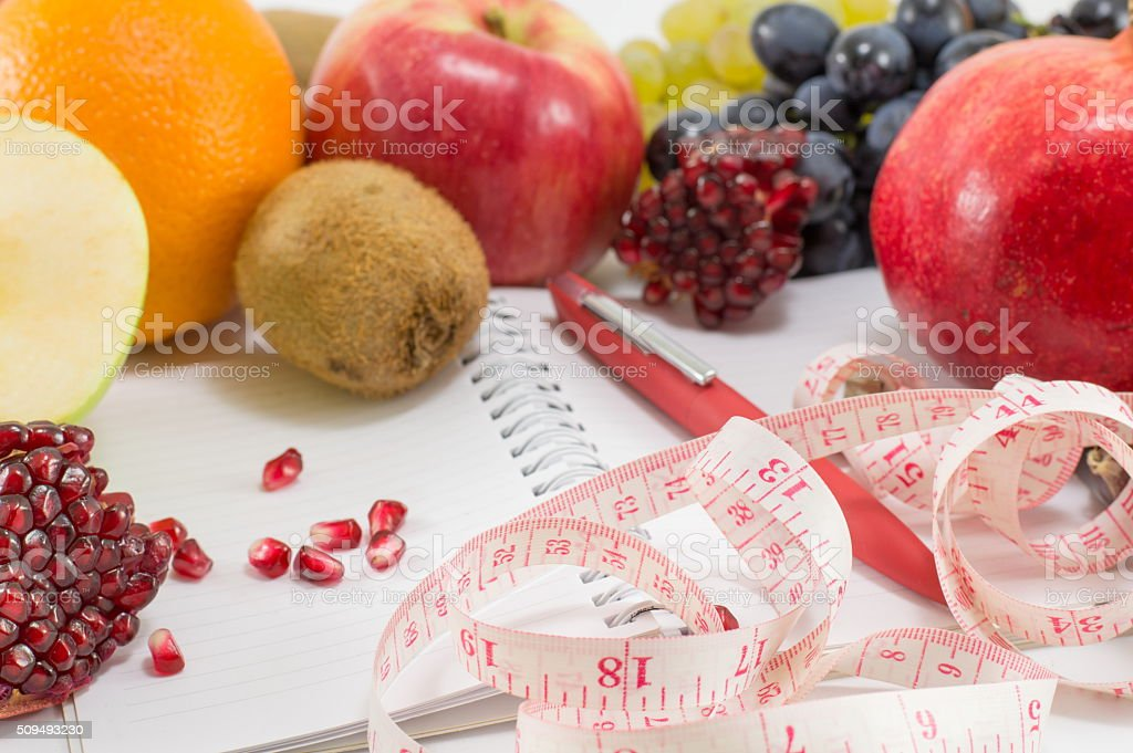 fruits notebook and a tape measure stock photo