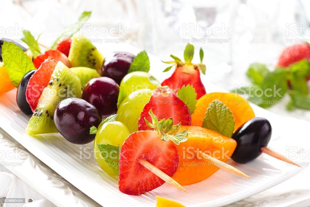 Fruits on sticks. stock photo
