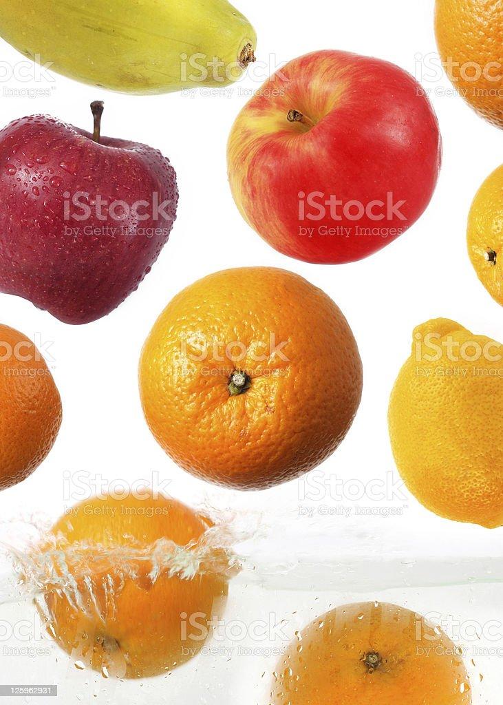 fruits splash in water stock photo
