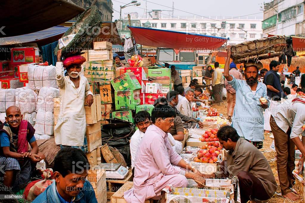 Fruits traders sell apples and oranges on street market stock photo
