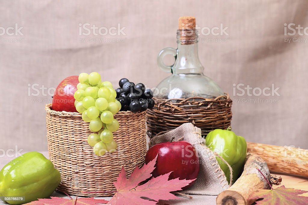 fruits, wine and autumn leaves royalty-free stock photo