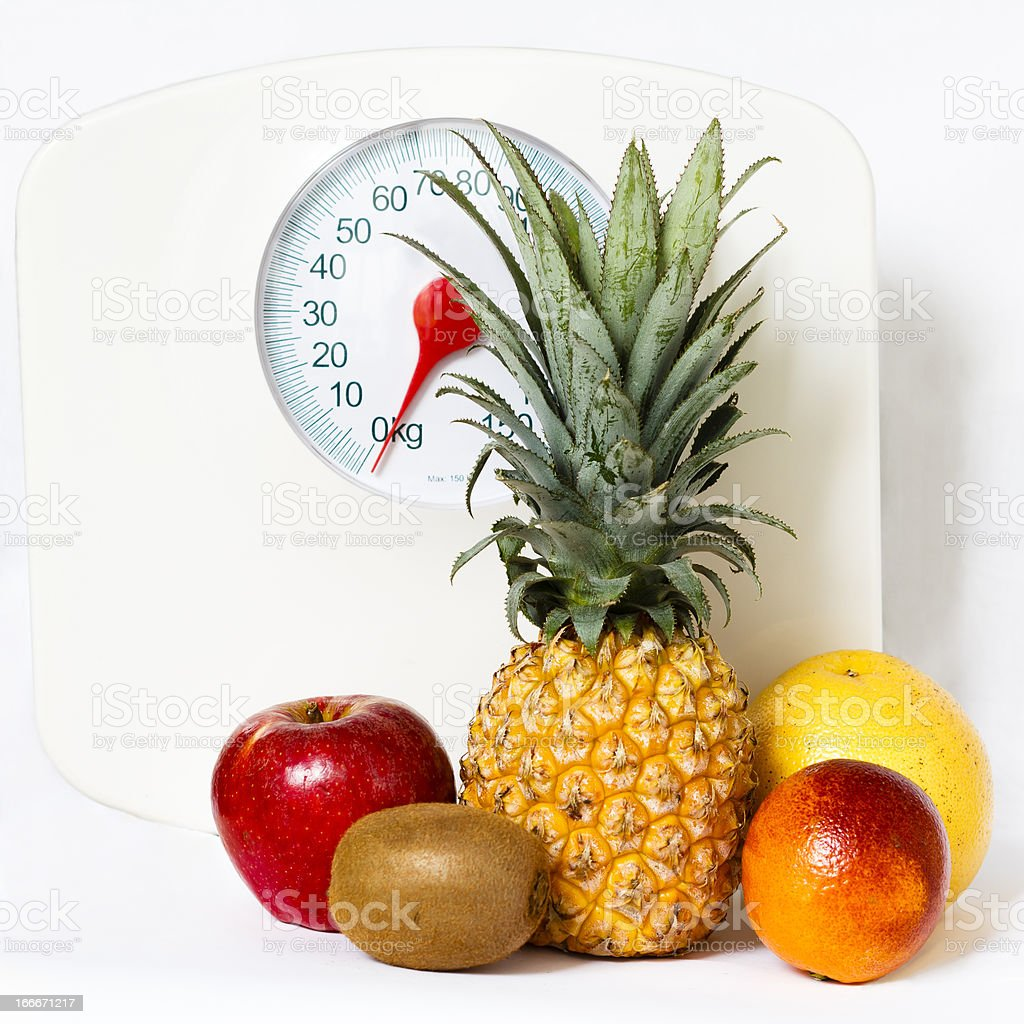 Fruits with a weight scale royalty-free stock photo