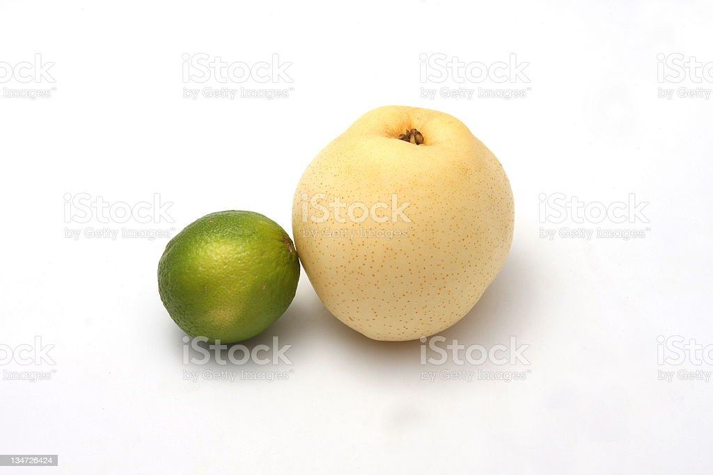 Fruits...asian pear and green lemon on white background royalty-free stock photo