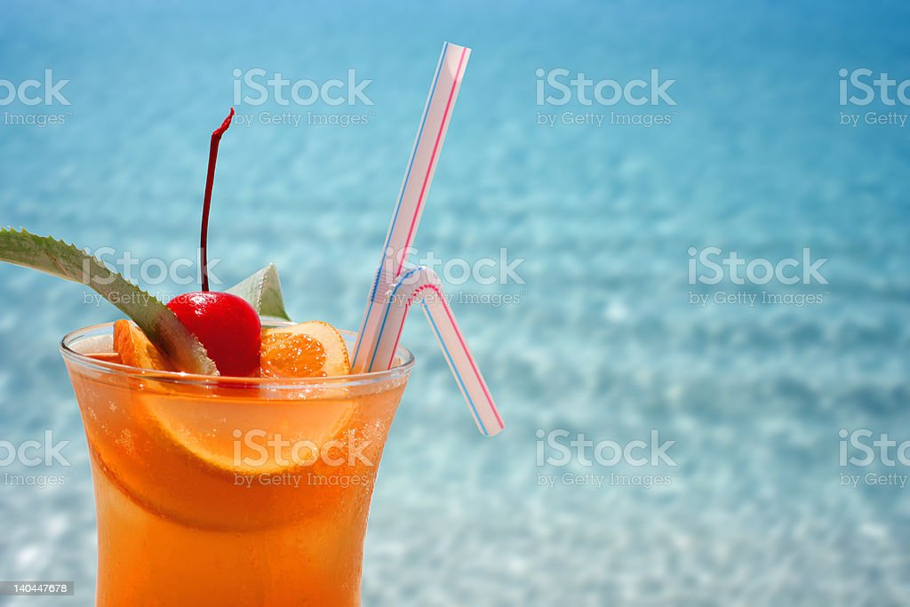 Fruity Cocktail and blue sea royalty-free stock photo