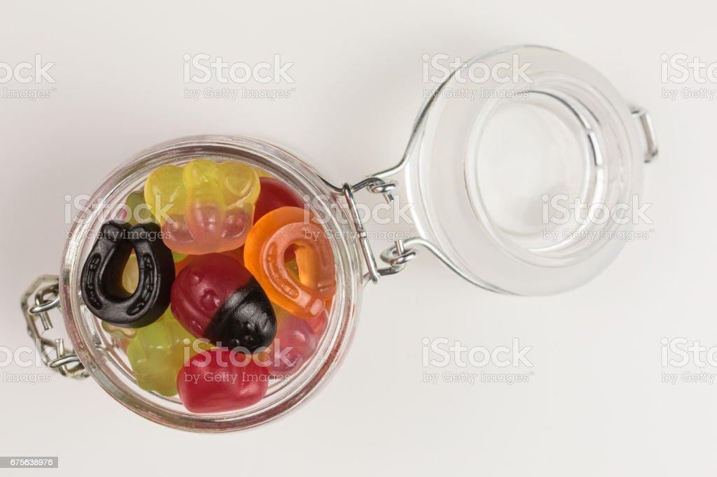 fruity gummy candies symbols in glass jar stock photo