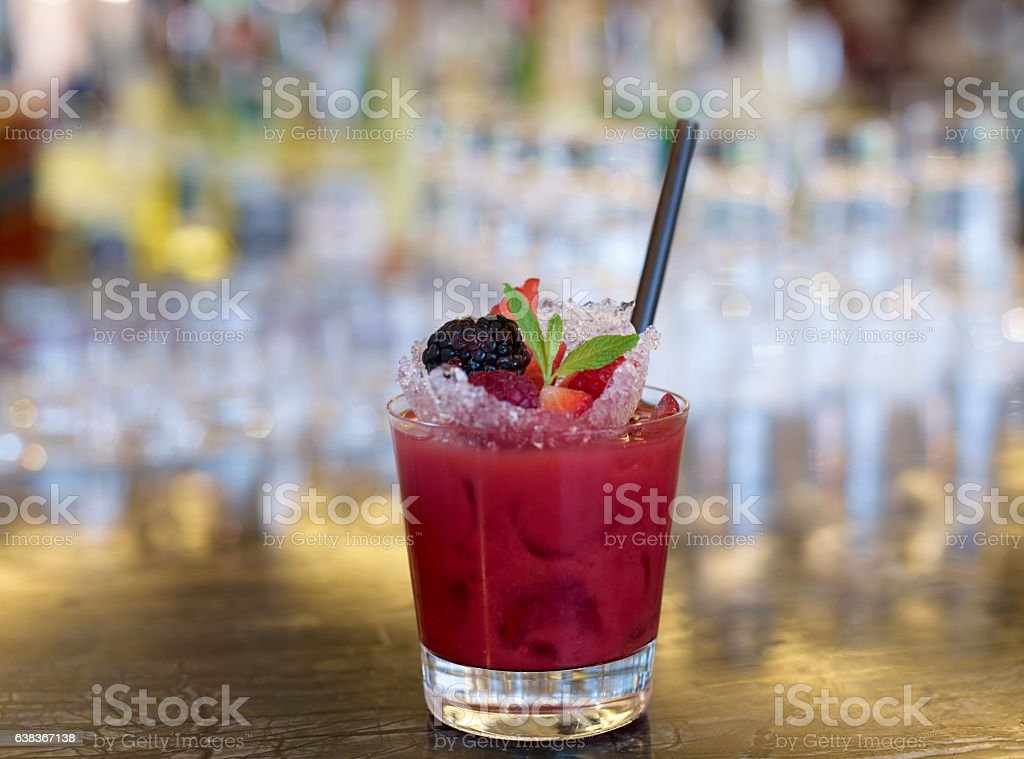 Fruity strawberry surrounded by fresh strawberries stock photo