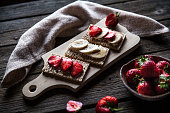 Fruity toast on wooden background. Strawberries