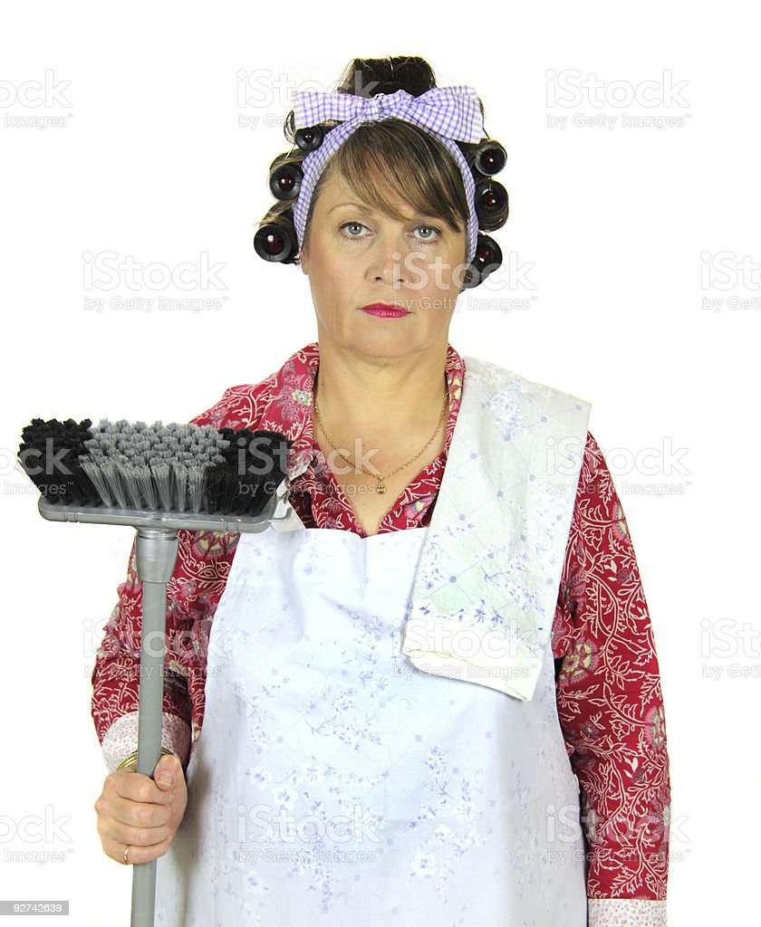 Frumpy Housewife With Broom stock photo