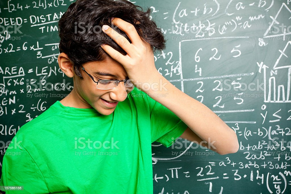 Frustated Confused Indian Teenager Student with Mathematics Problems royalty-free stock photo