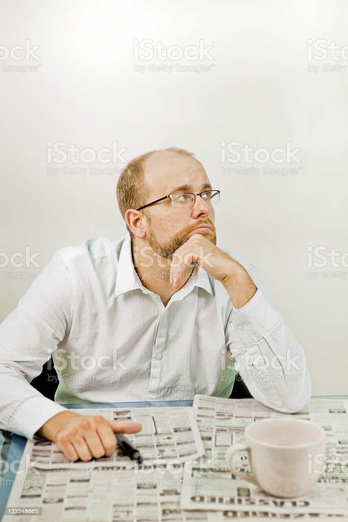 Frustraded man looking for job royalty-free stock photo