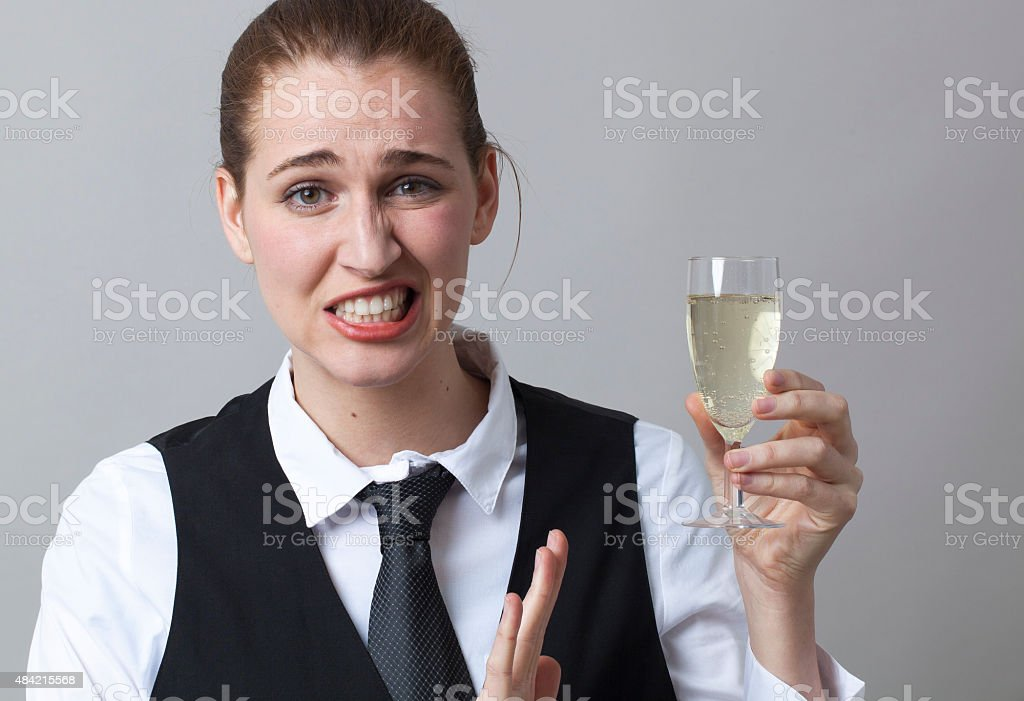 Frustrated 20s girl resisting in drinking more Champagne at party stock photo