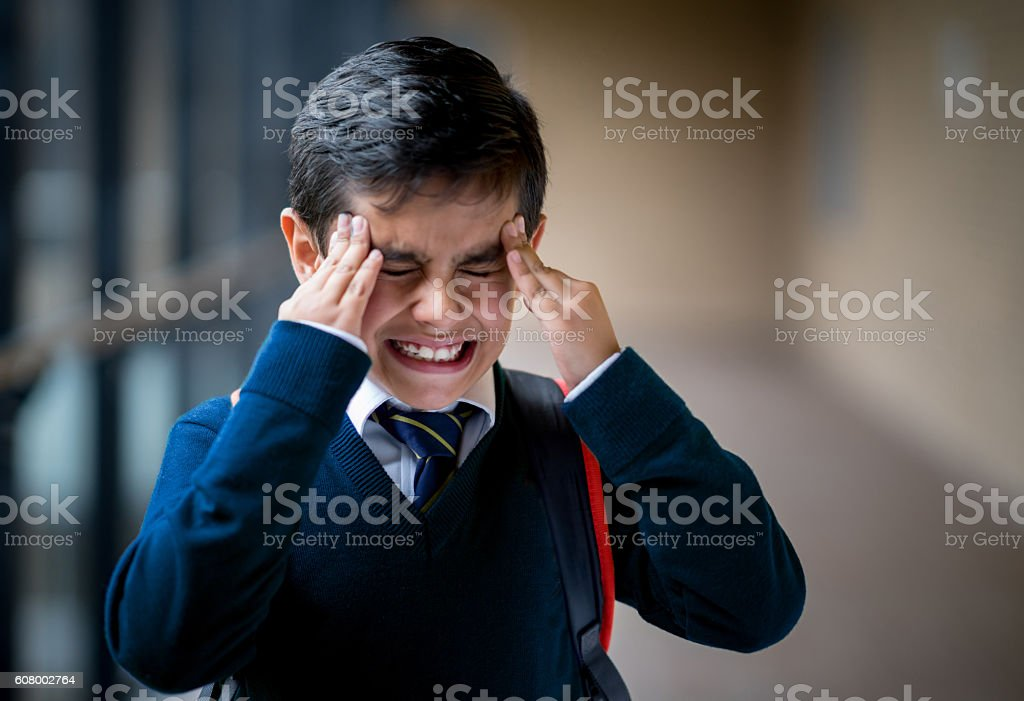 Frustrated boy at school stock photo