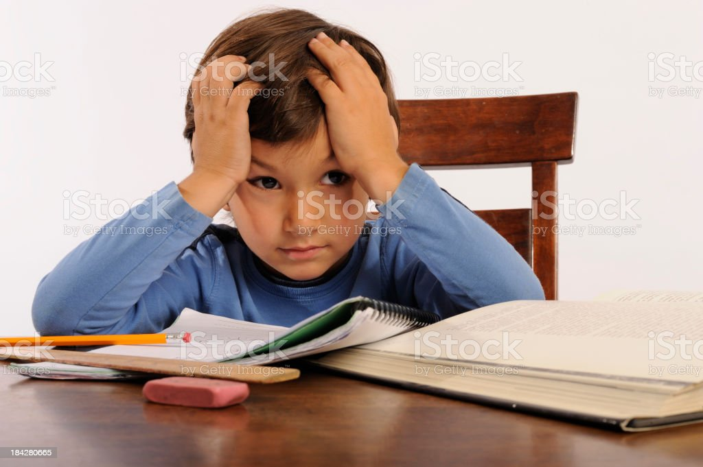 Frustrated boy sitting in chair after studying royalty-free stock photo