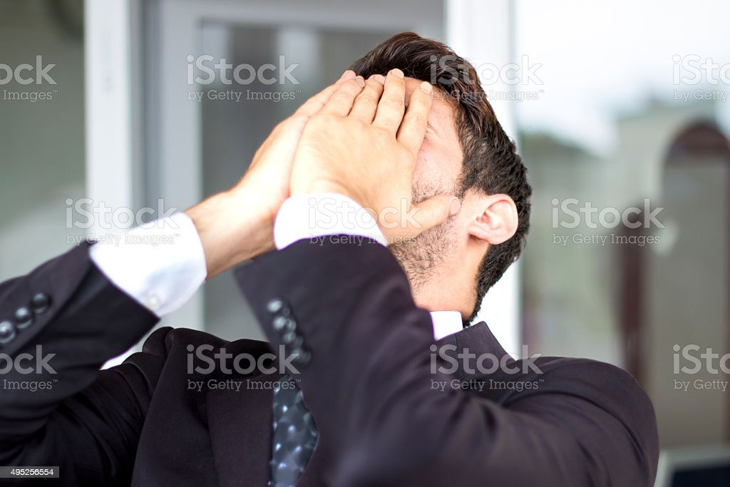 Frustrated businesman in office stock photo