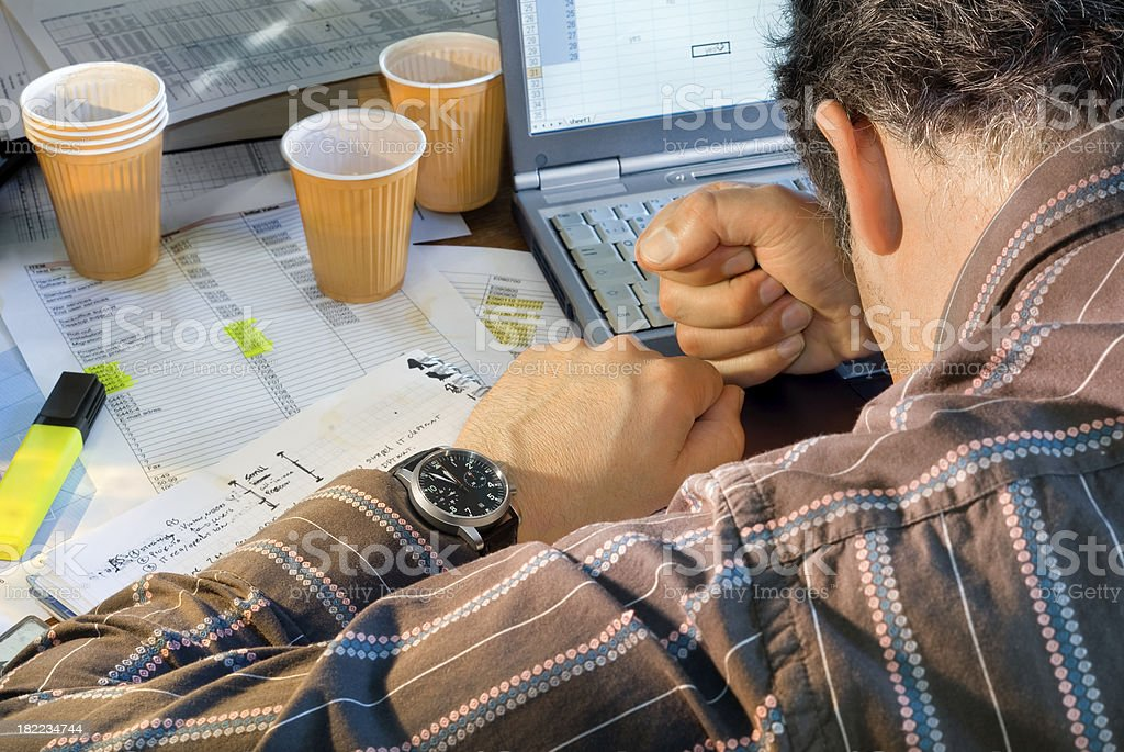 Frustrated business man trying to reach his deadline stock photo