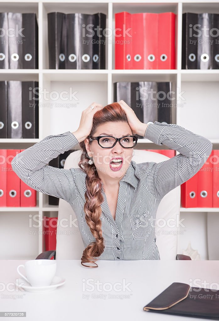Frustrated business woman in glasses screaming stock photo