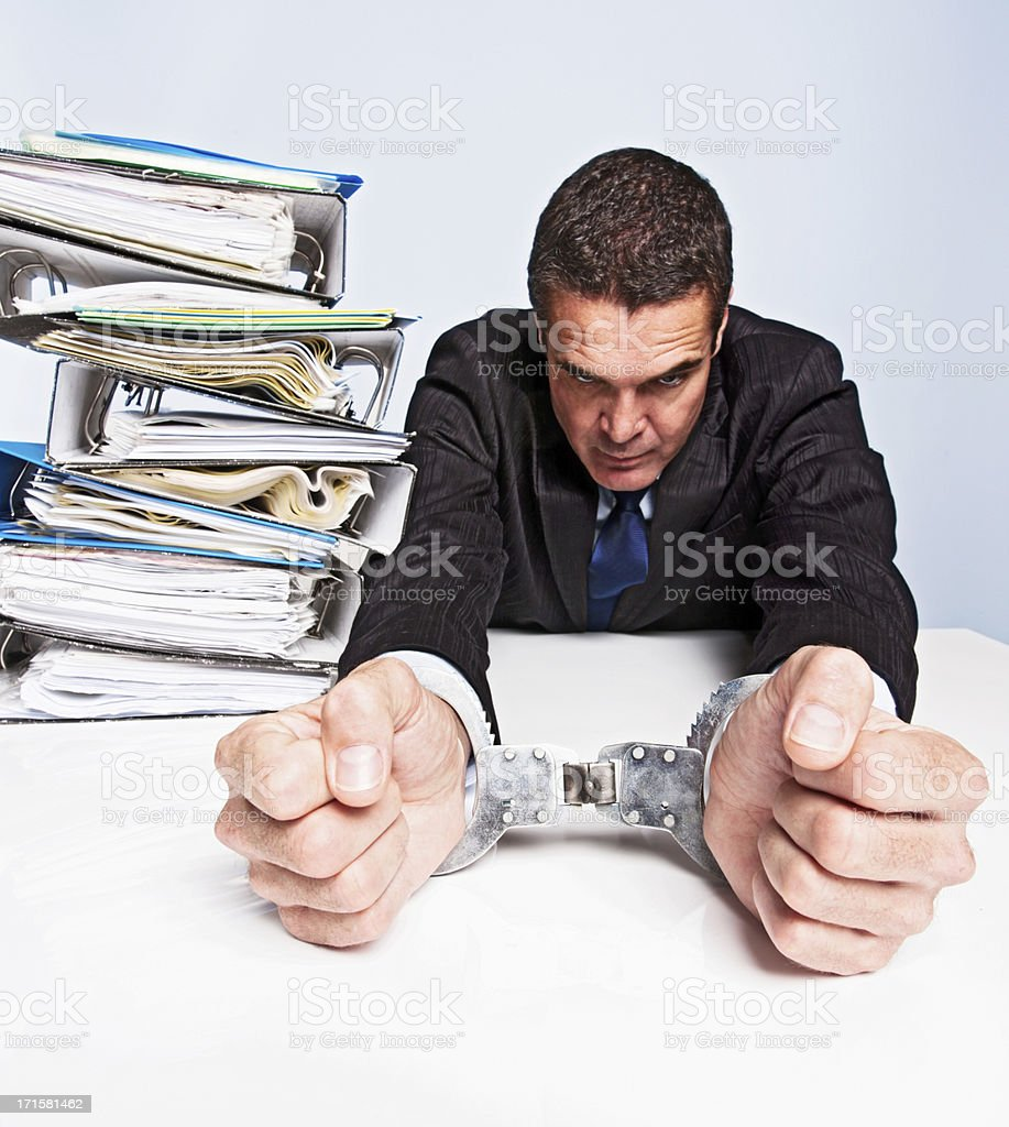 Frustrated businessman cannot function: his hands are tied - literally royalty-free stock photo