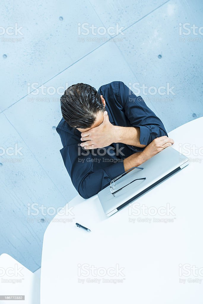 Frustrated businessman in board room royalty-free stock photo