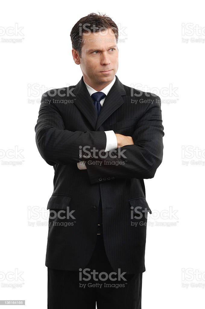 Frustrated Businessman Standing with Arms Crossed Isolated on White Background royalty-free stock photo