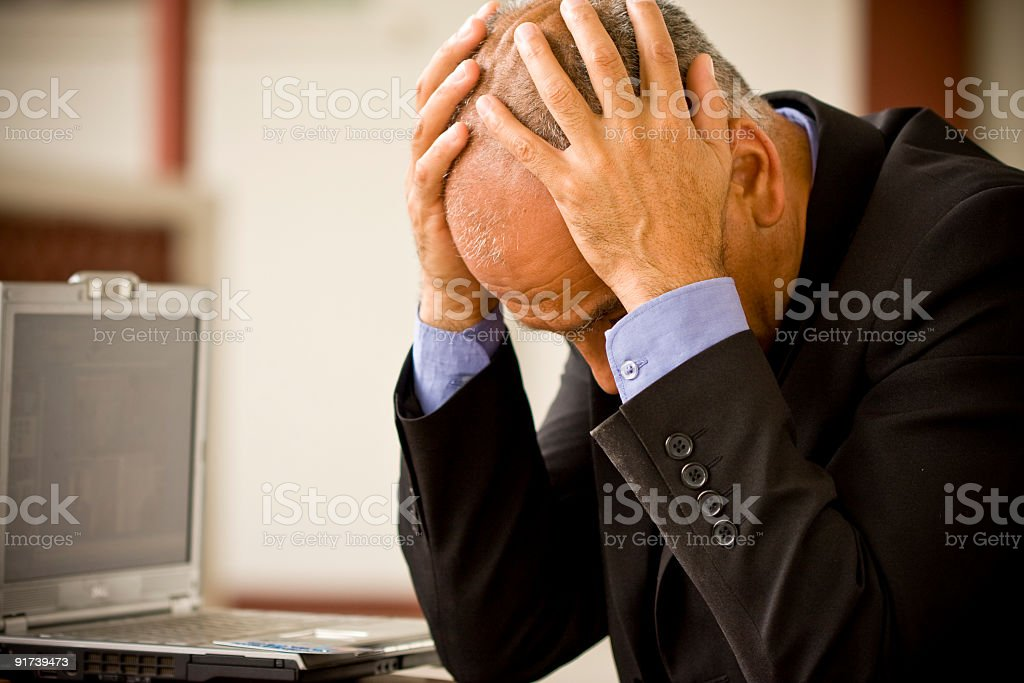 Frustrated Businessman with laptop royalty-free stock photo