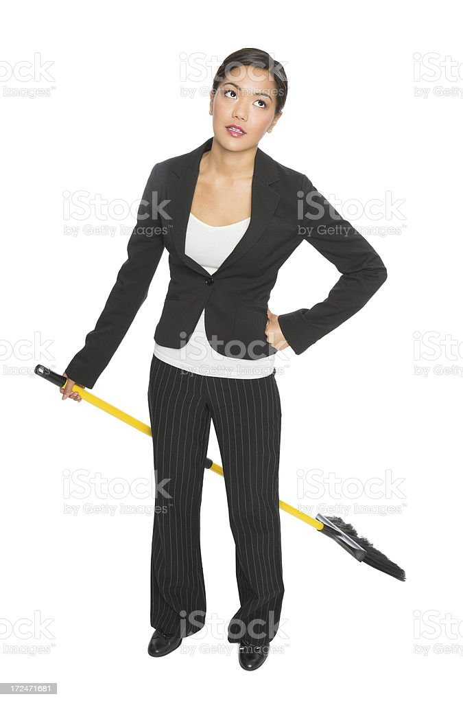 Frustrated Businesswoman Holding Broom royalty-free stock photo
