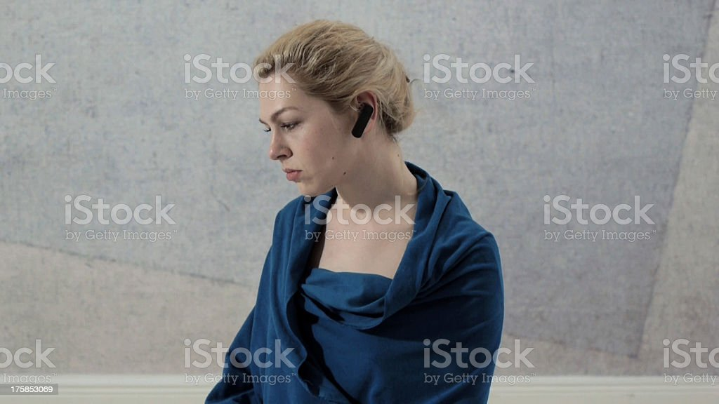 Frustrated CEO wearing bluetooth device royalty-free stock photo