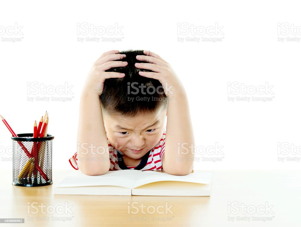 Frustrated child with a book stock photo