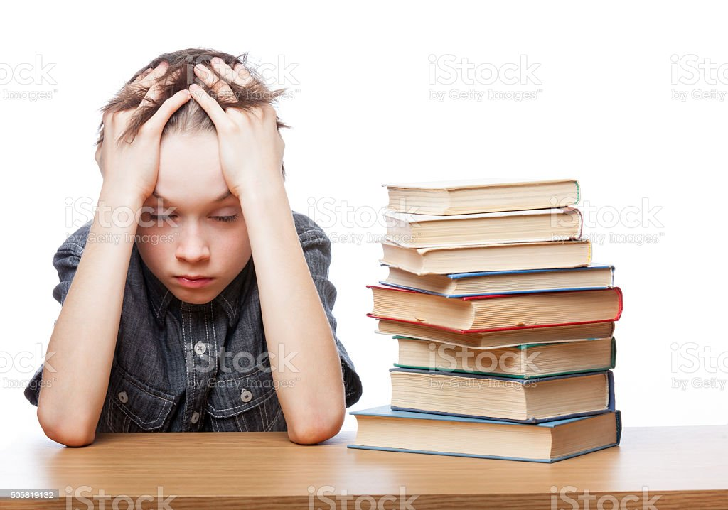 Frustrated child with learning difficulties stock photo