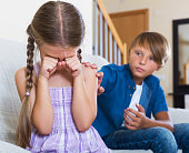 Frustrated children having serious fight