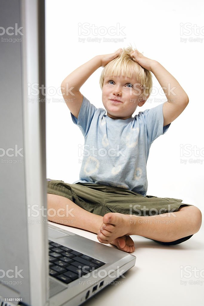 Frustrated computer boy stock photo