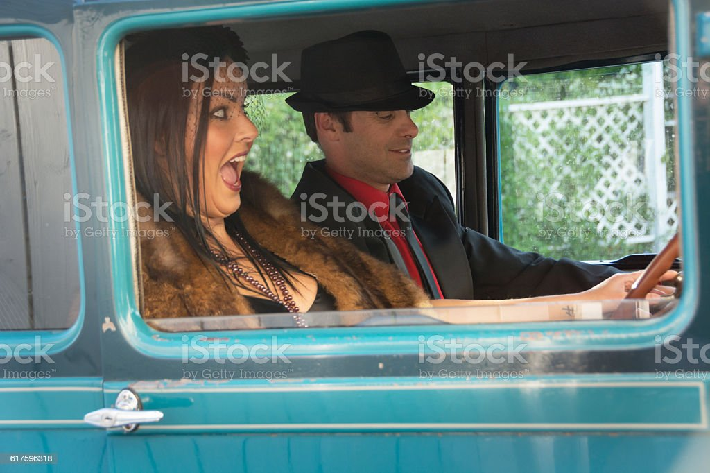 Frustrated couple in vintage car that won't start. stock photo