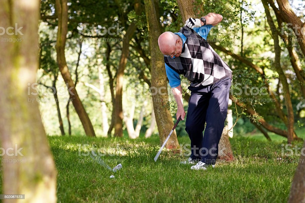Frustrated golfer in the rough stock photo