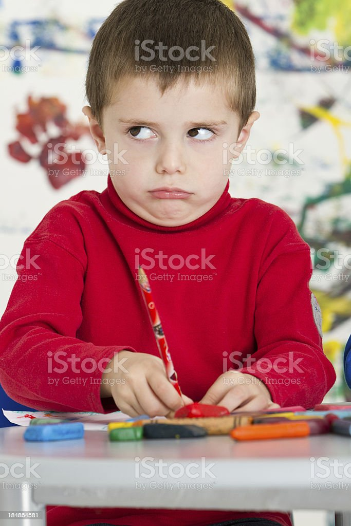 Frustrated little boy at class royalty-free stock photo