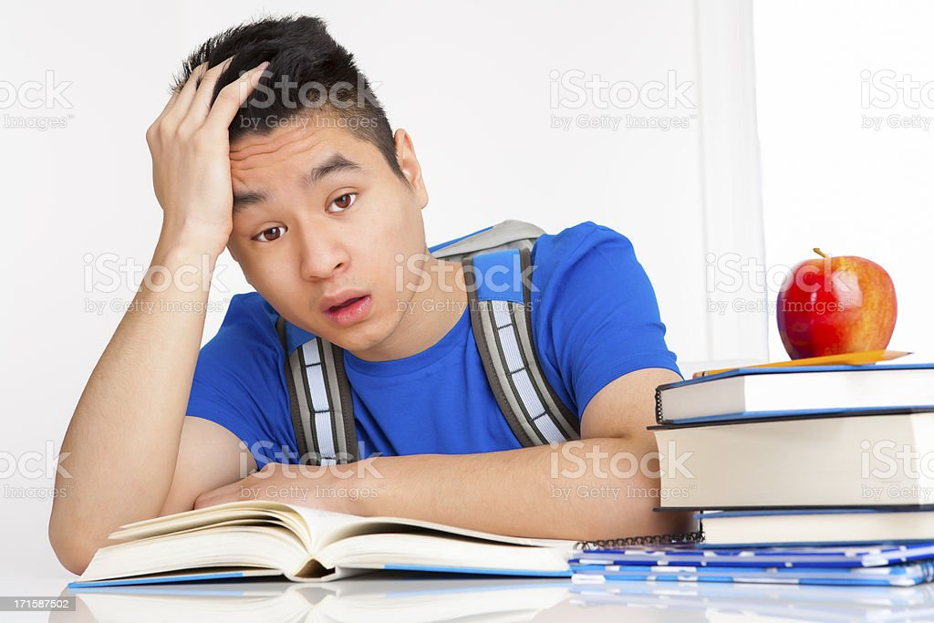 Frustrated male student studying royalty-free stock photo