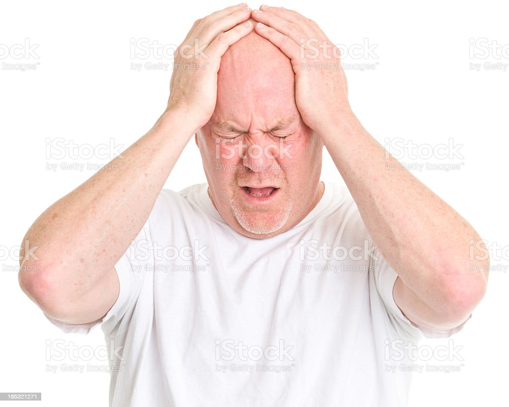Frustrated Man Holds Head royalty-free stock photo