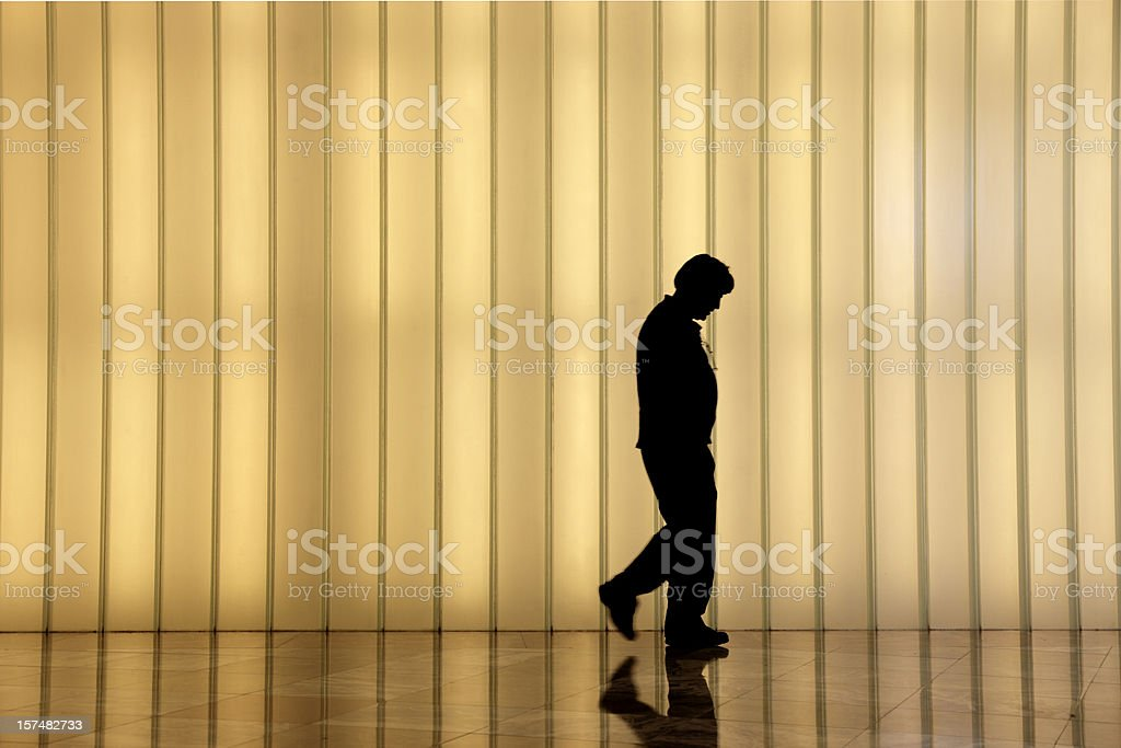 frustrated man in front of modern light wall royalty-free stock photo