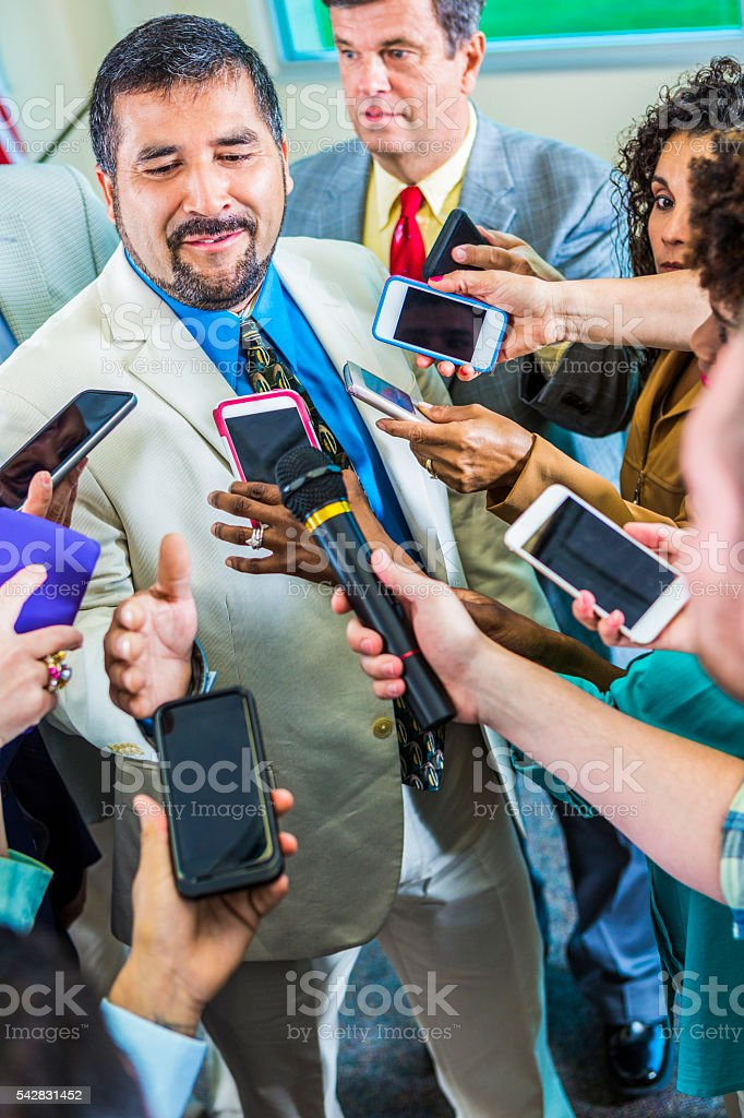 Frustrated man speaks to journalists stock photo