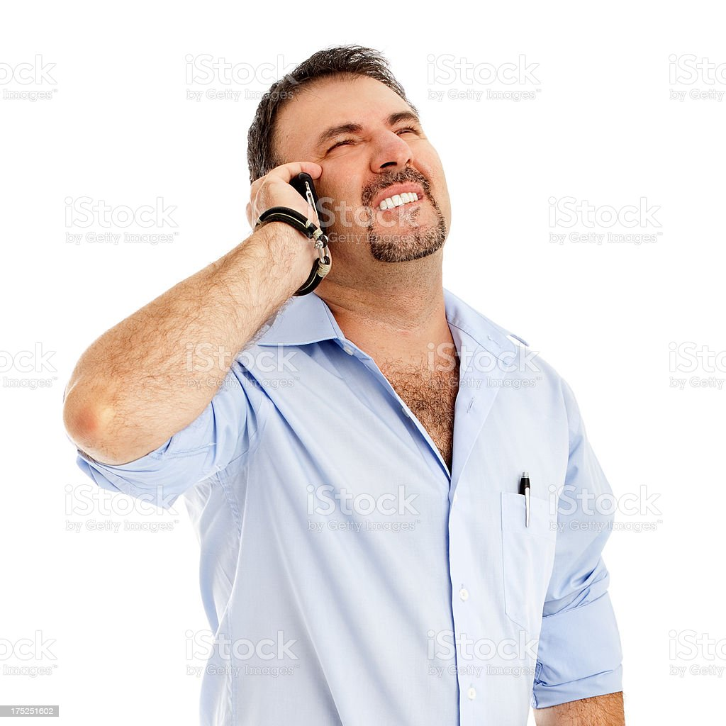 Frustrated man talking on the phone royalty-free stock photo