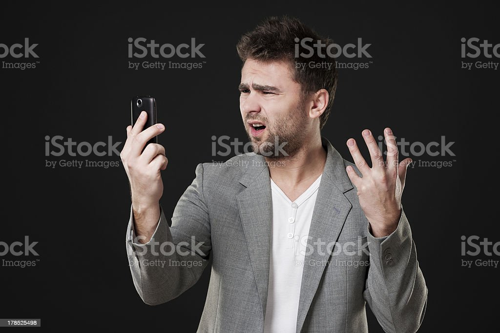 Frustrated man with mobile phone royalty-free stock photo